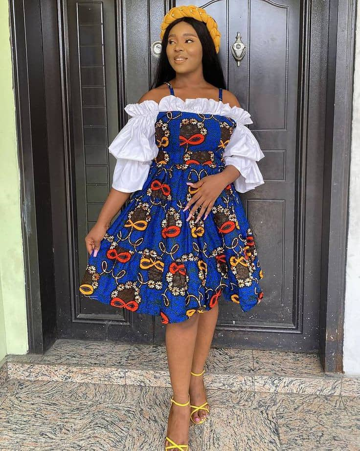 smiling lady wearing ankara dress with a touch of white plain material