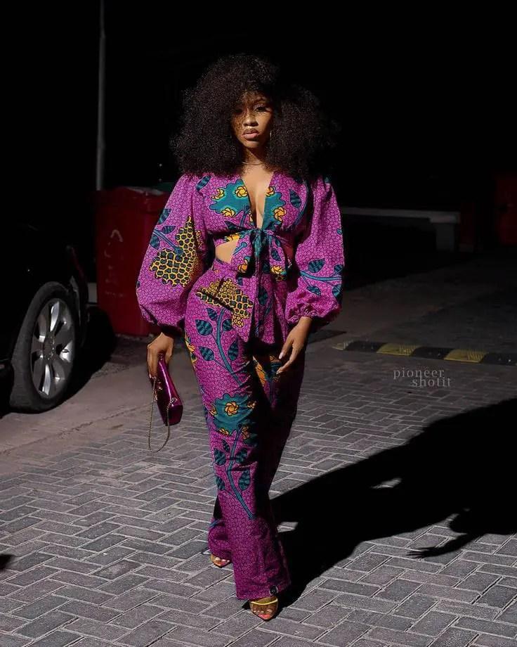 lady walking in ankara top with matching pants