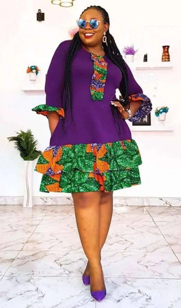 lady wearing a short purple plain material/ankara dress