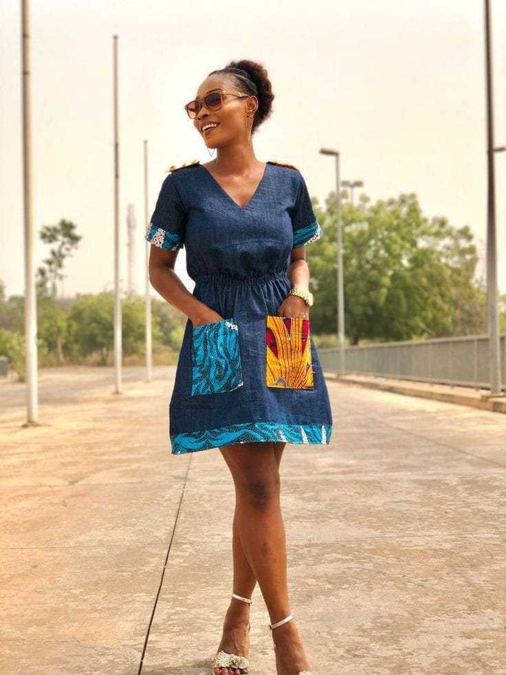 lady wearing denim dress with a touch of ankara