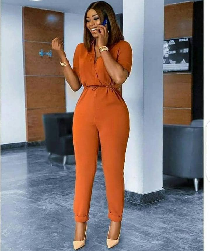lady wearing orange jumpsuit with heels