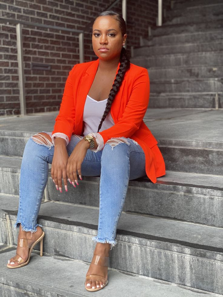 lady wearing orange blazer with jeans