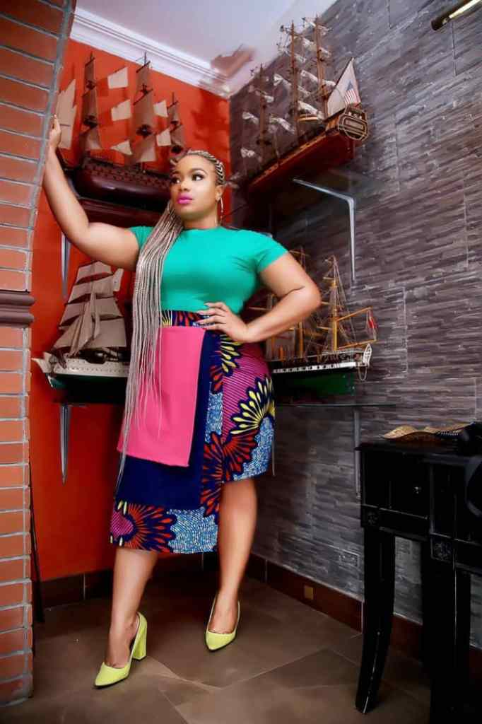 lady wearing plain top with ankara/plain skirt