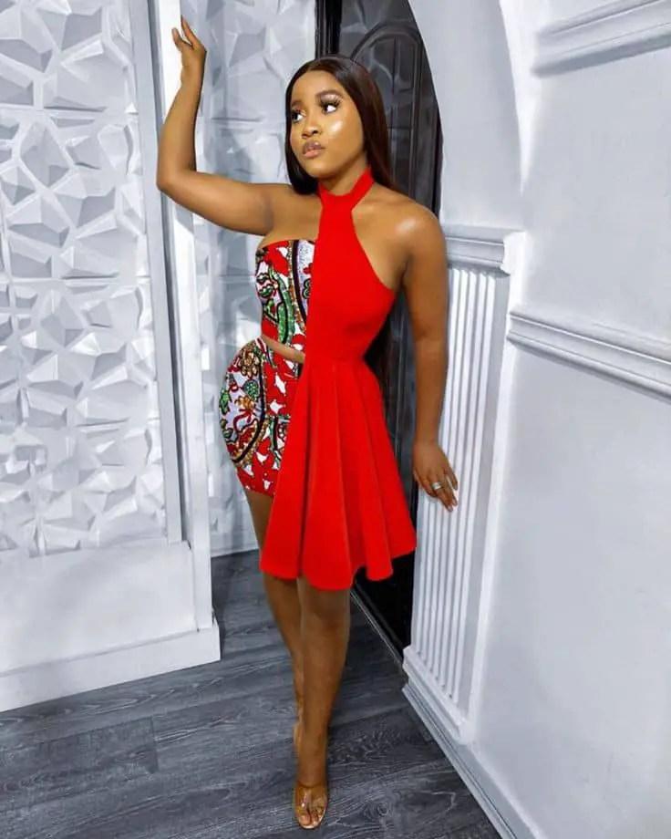 lady wearing short ankara/red plain material dress