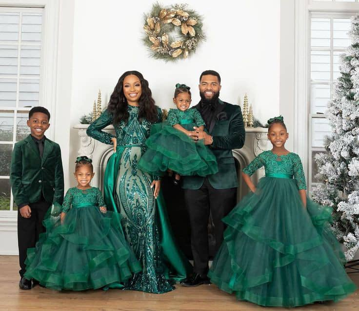 black family wearing matching green and black dinner outfits