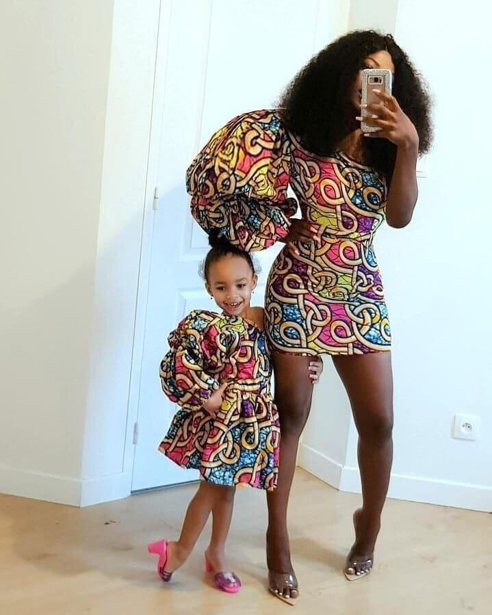 lady and her daughter wearing matching ankara dresses