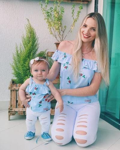 mother and daughter rocking matching tops and white jeans