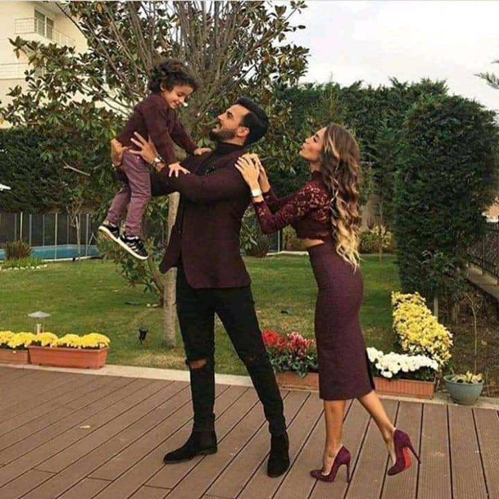 European family wearing matching brown outfits