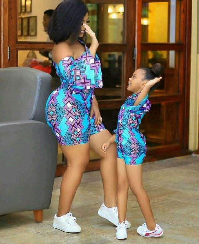 lady and daughter wearing matching ankara playsuits