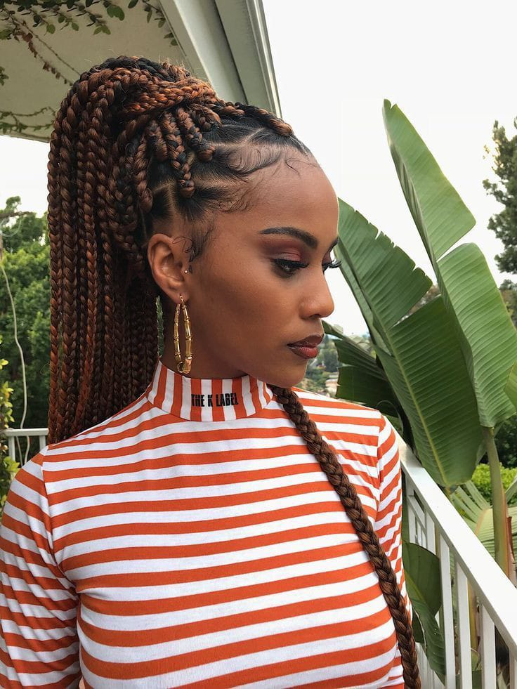 lady with beautiful edges rocking brown braids