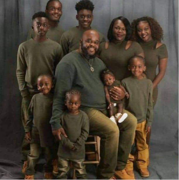 large black American family wearing army green outfits