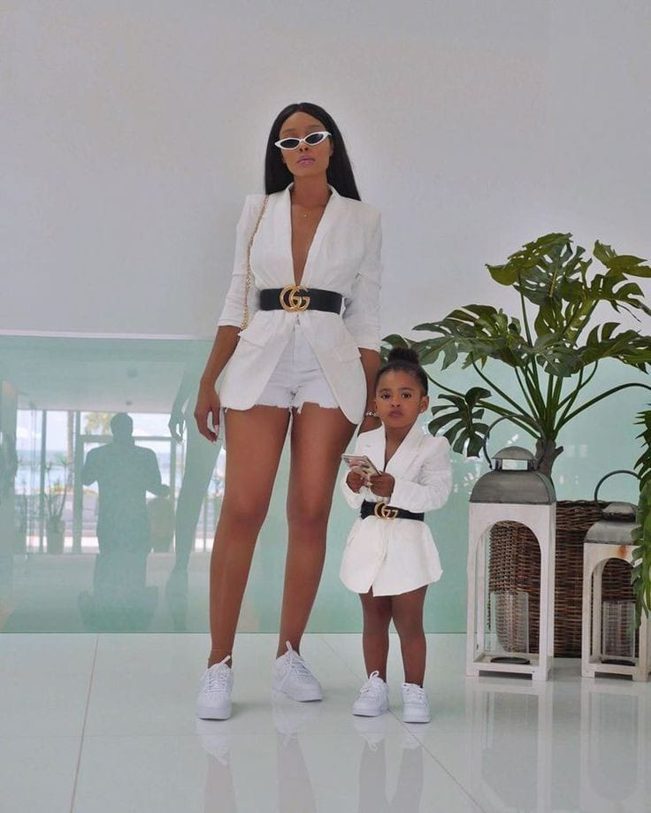 mother and daughter wearing matching blazers