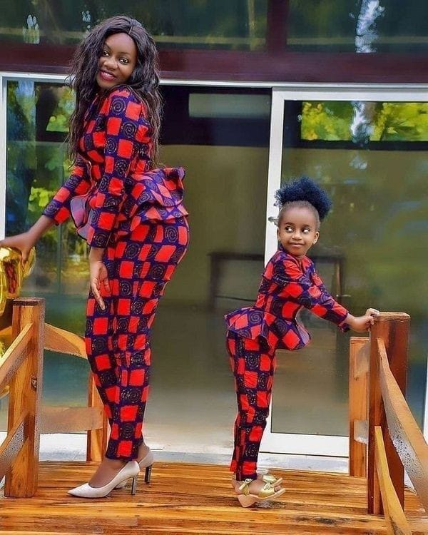 mother and daughter wearing matching ankara top and pants