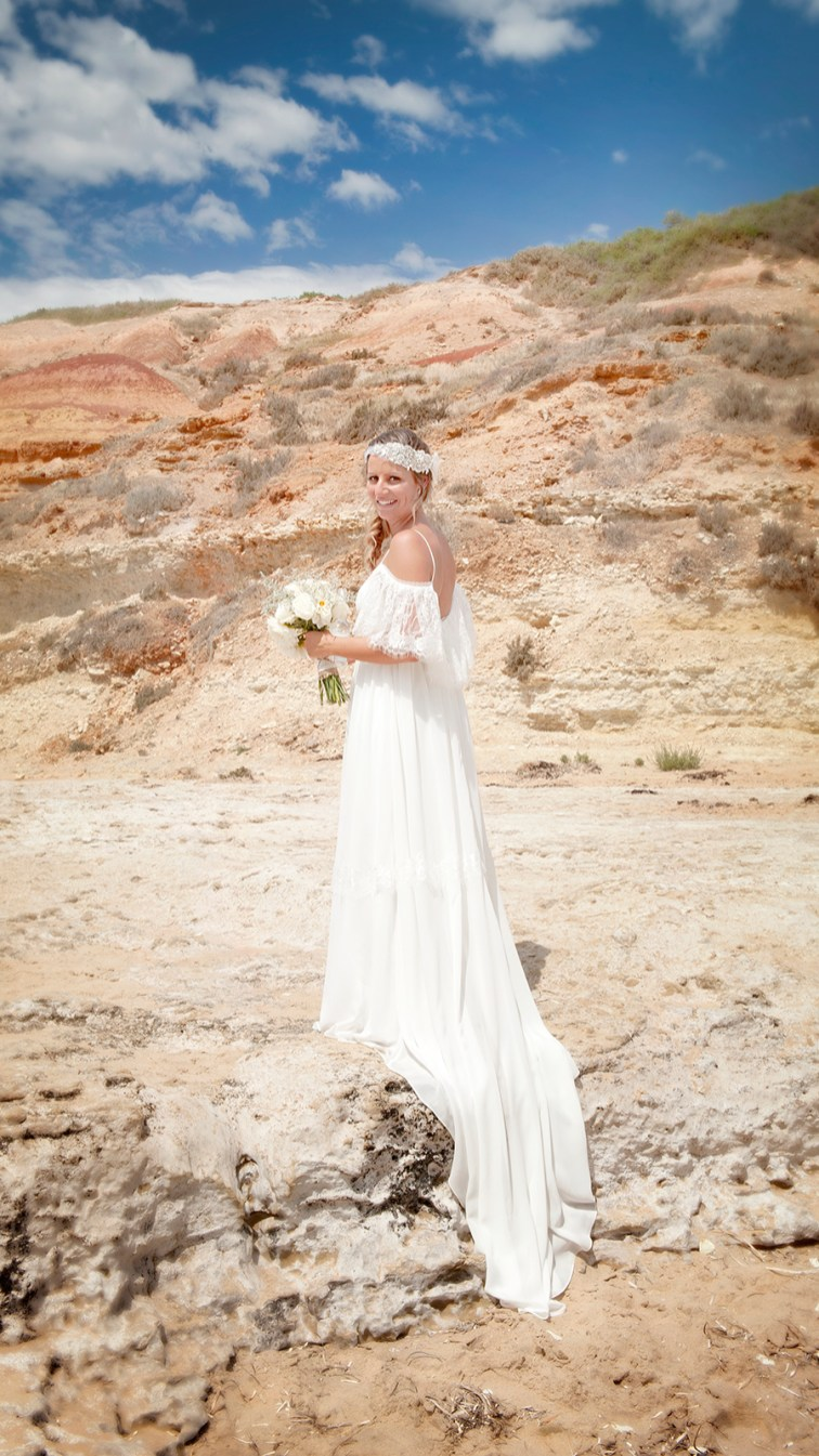 Wedding dress at Southport beach