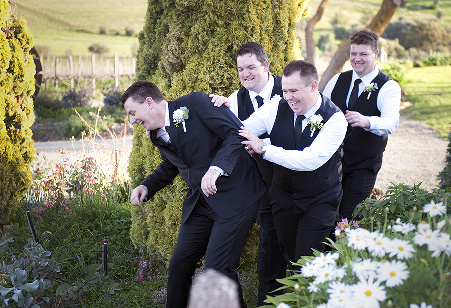 Groomsmen being silly at Coriole Vineyards