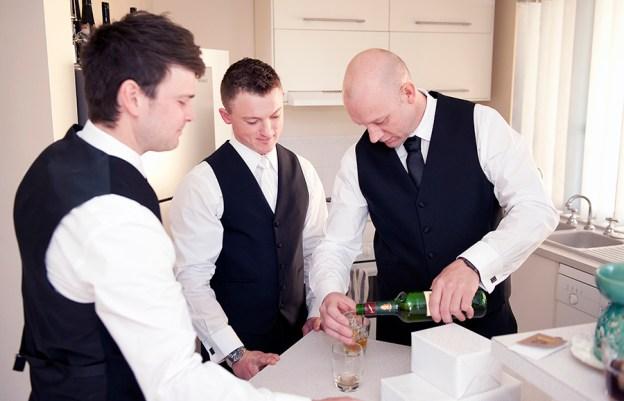 Groomsmen drinking