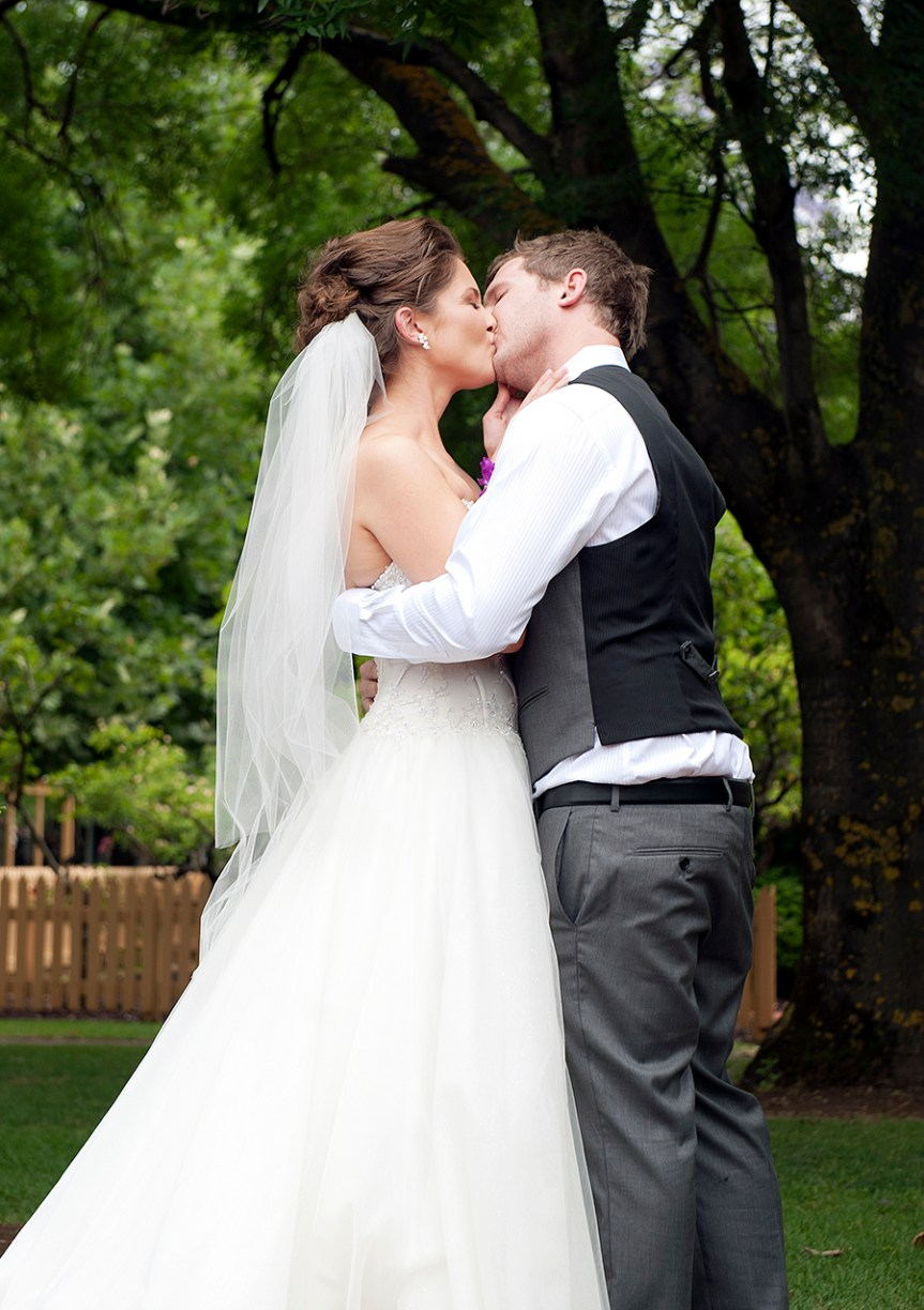 Wedding kiss at Sunnybrae Function Center