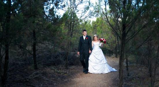 Bride and Groom walking on path