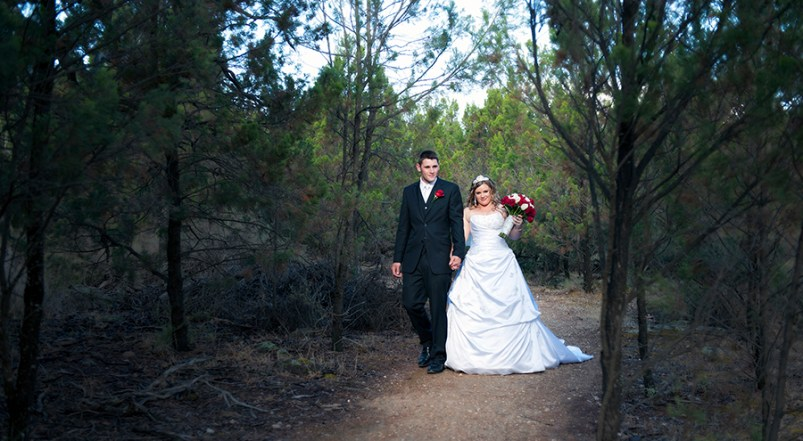 Bride and Groom walking on path