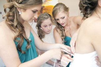Bridal Party putting on dress