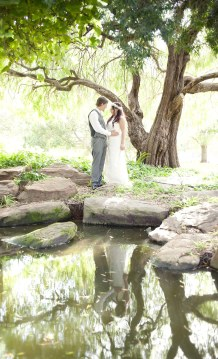 Bride and groom under tree