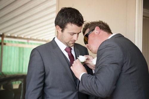 Groomsmen putting on Tie