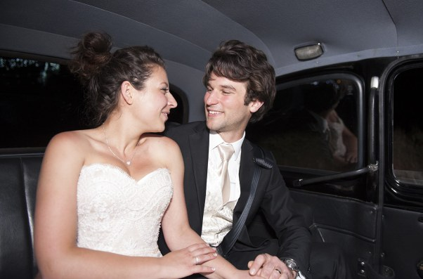 Bride and Grioom in car