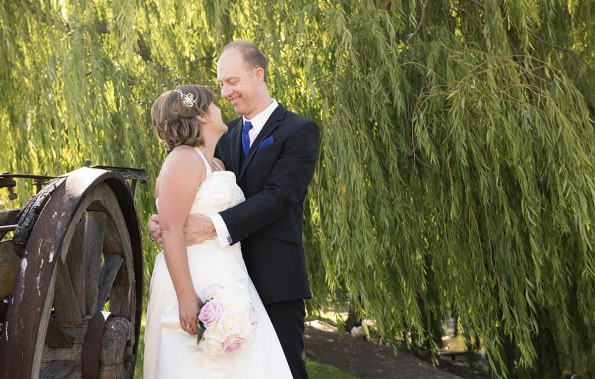Bride and groom under willows