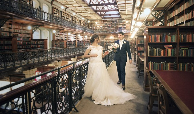 Bride and groom in library
