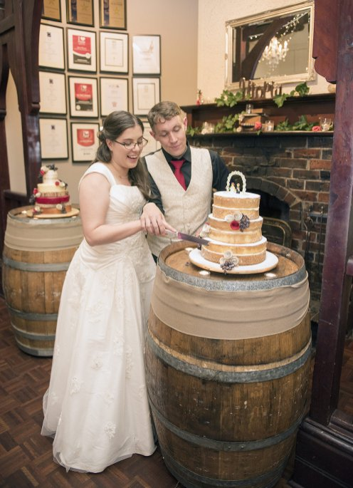 Bride and groom cutting cake
