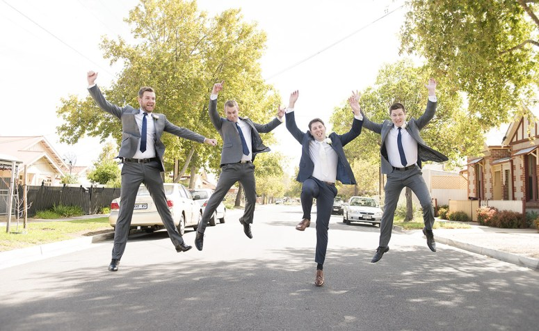 grooms men jumping