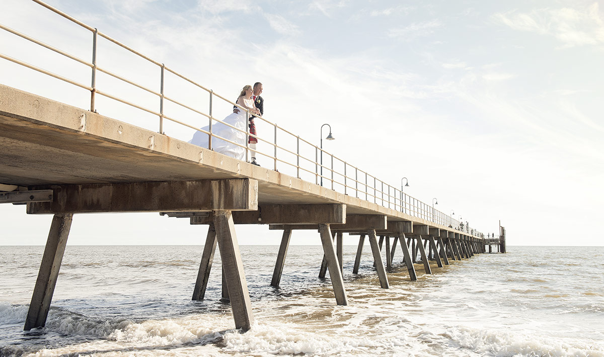 Bride and groom on Glenelgs Jetty