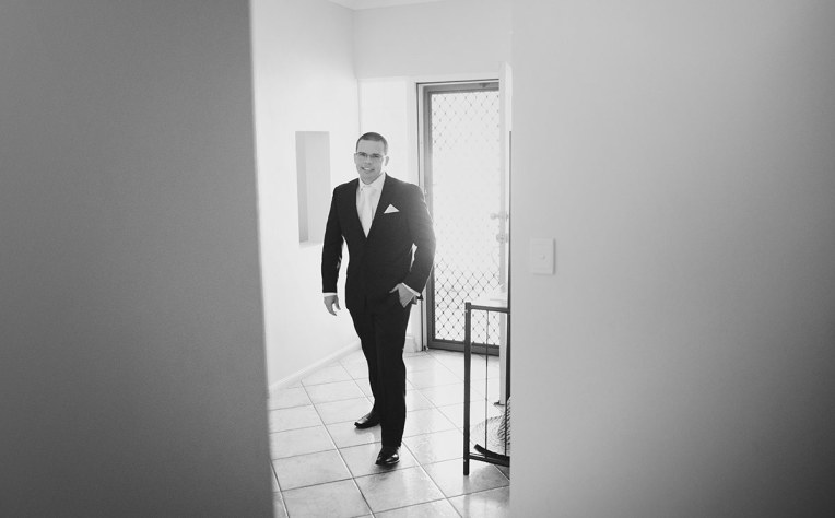 Groom in doorway