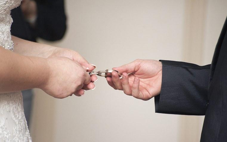 Bride and groom holding locks
