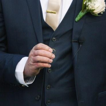 Holding wedding ring