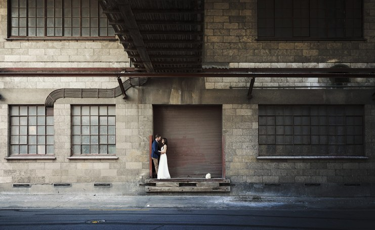 Bride and groom in front of woolsheds