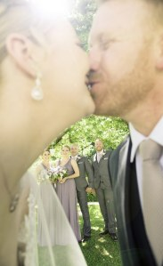 Bridal party through a kiss