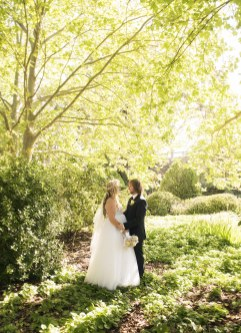 Bride and groom in park