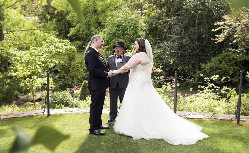 Bride and groom with celebrant