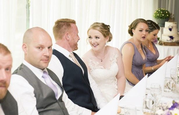Bride smiling at groom