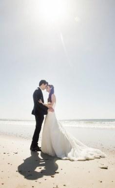 Bride and groom under sun