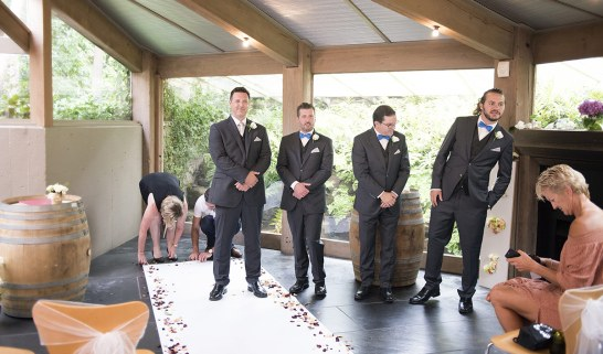 Groom and groomsmen at altar