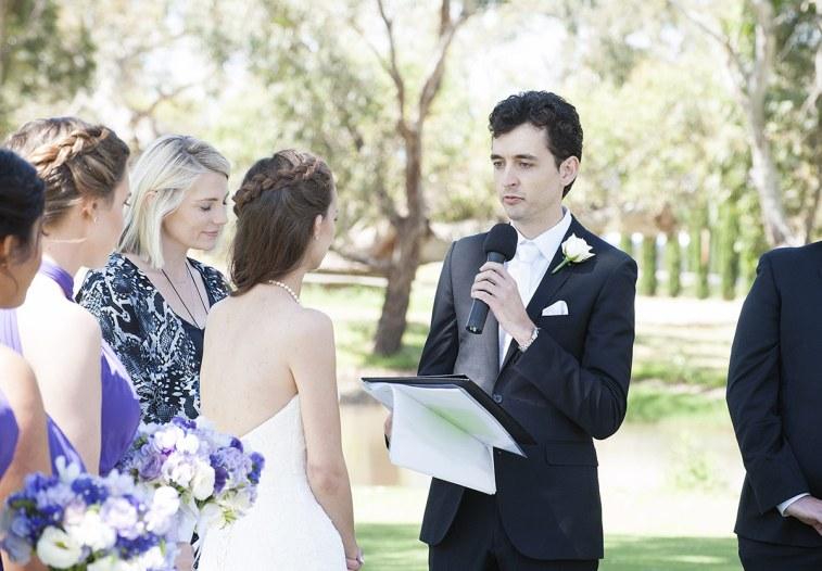 Groom speaking his vows