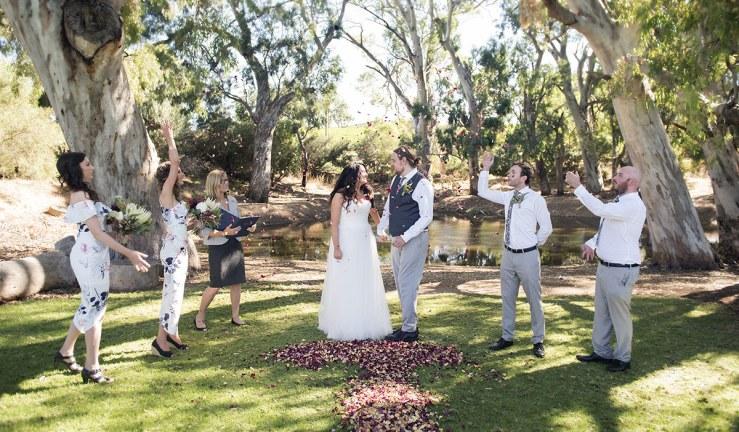 Bridal party throwing petals