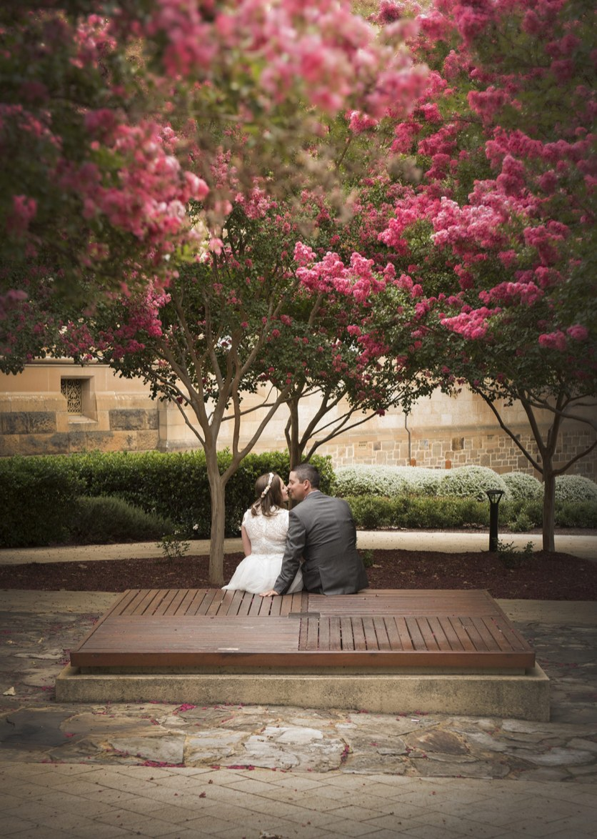 Wedding couple under flowers