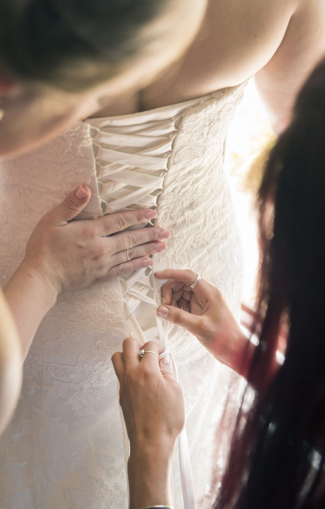Putting on wedding dress