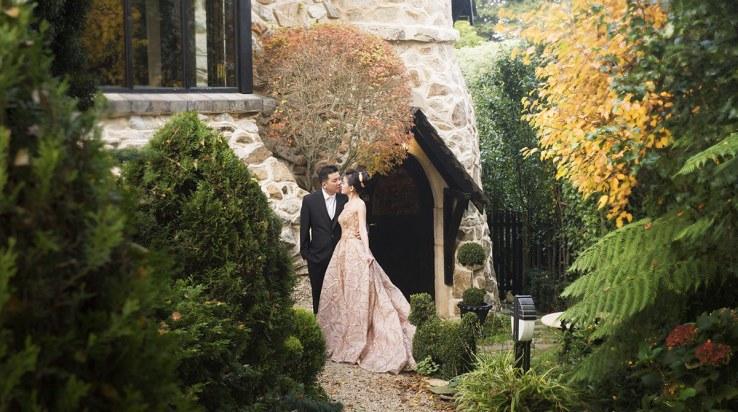 Bride and groom standing in front of their hotel door
