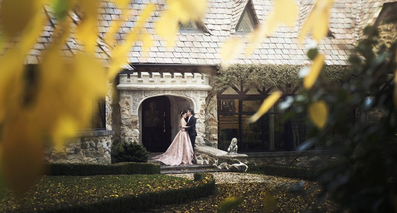 Engaged couple at the door of Thorngrove Manor