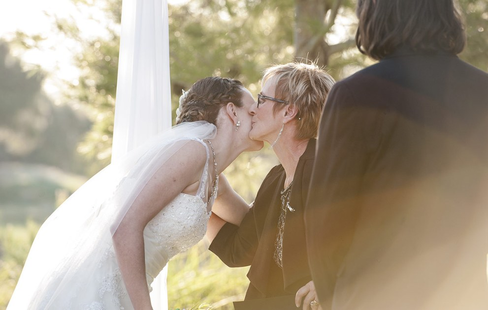 Bride kissing speech giver
