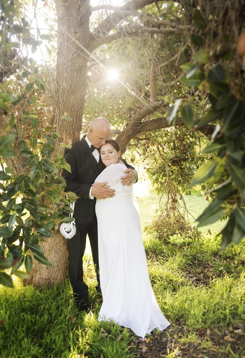 Hugging under a tree